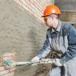 Процесс механизированной штукатурки стен