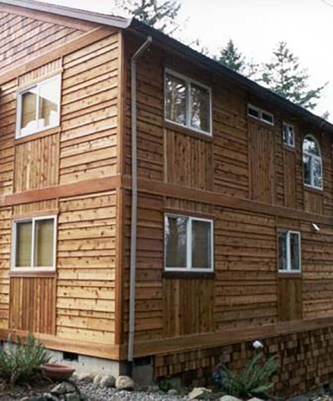 otdelka-fasada-doma-neobreznoj-doskoj